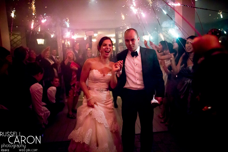 Bride and groom during sparkler exit