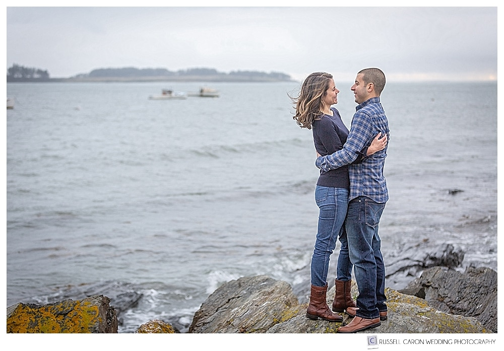 man and woman standing together at Kettle Cove, Cape Elizabeth, Maine, during their coastal Maine engagement photo session