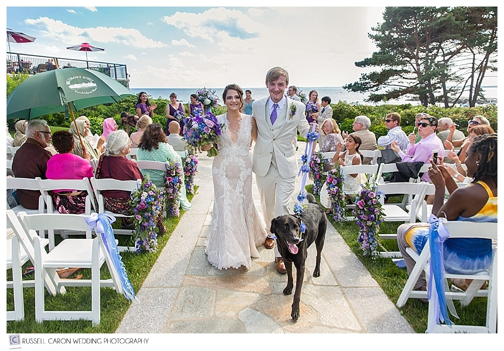 bride, groom and dog during recessional