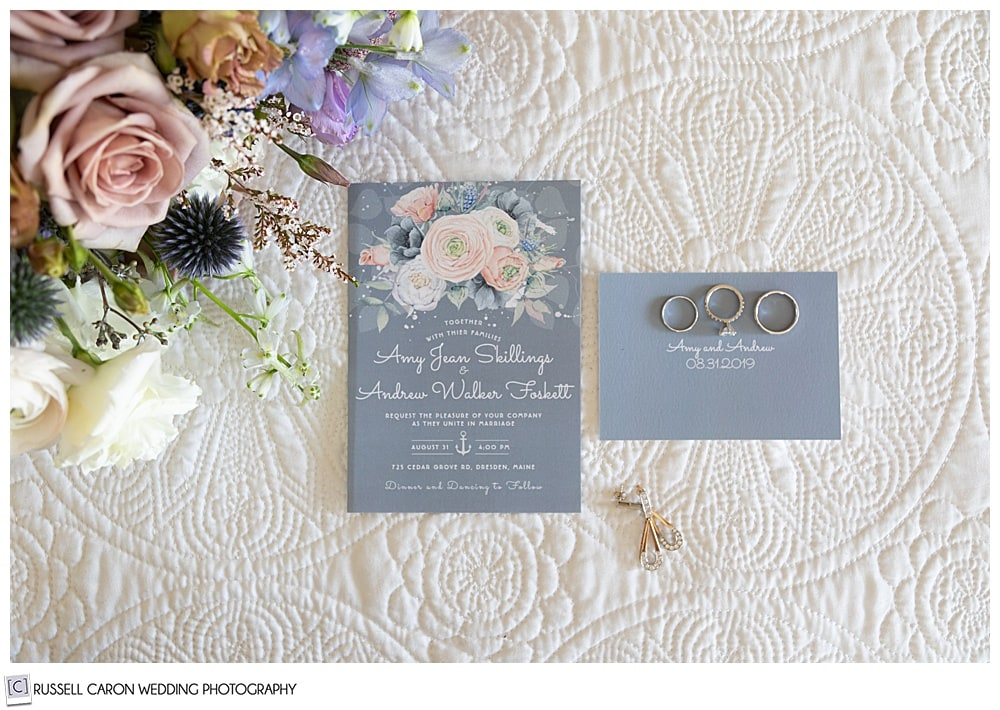 wedding day details, bouquet, rings, and paper suite