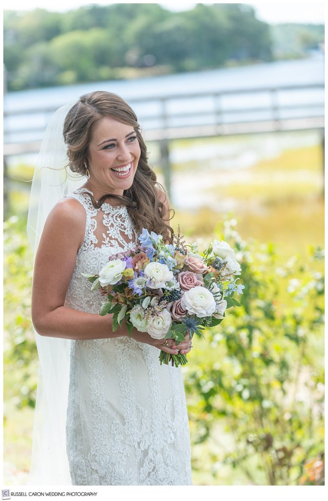 bride smiling during her wedding day first look photos