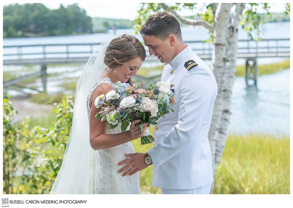 bride and groom in dress whites, at their wedding day first look
