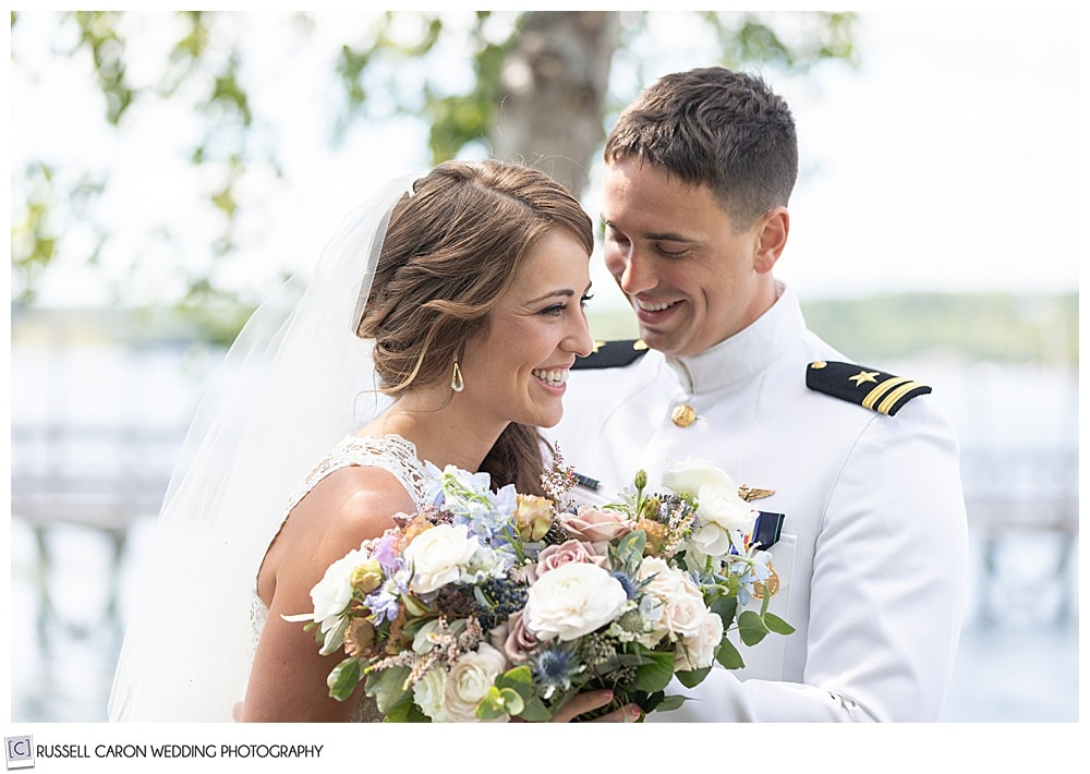 bride and groom smiling during their wedding day first look photos