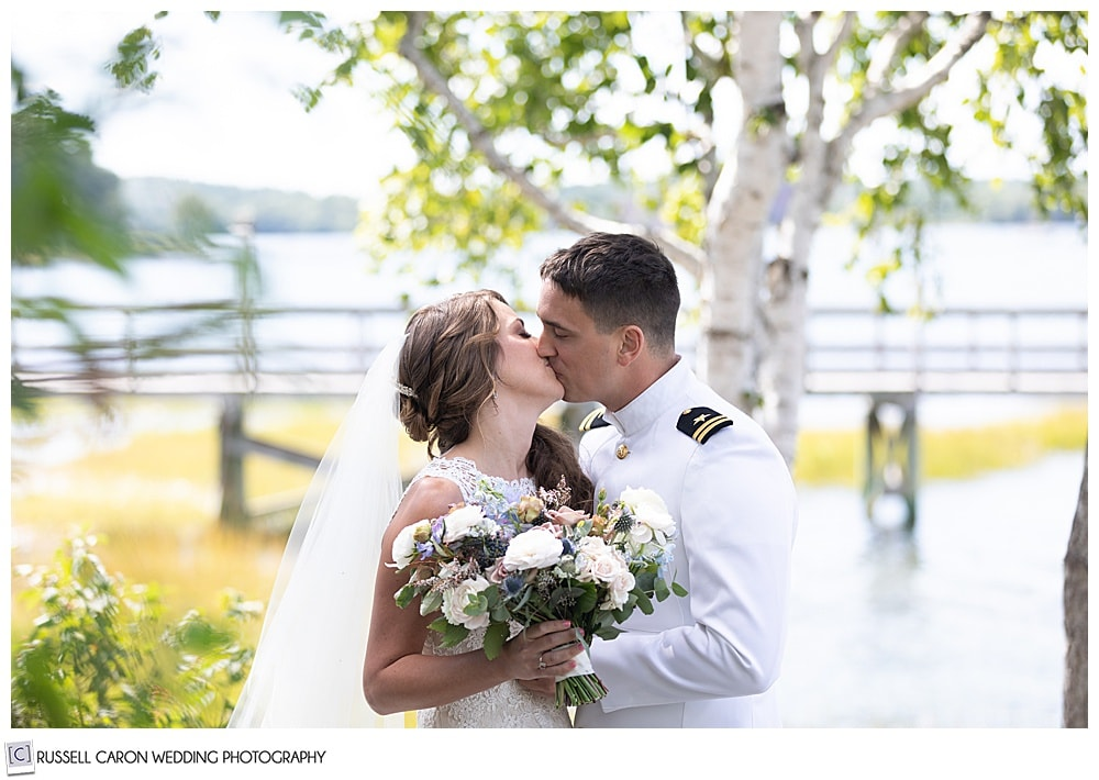 ride and groom kissing during their first look