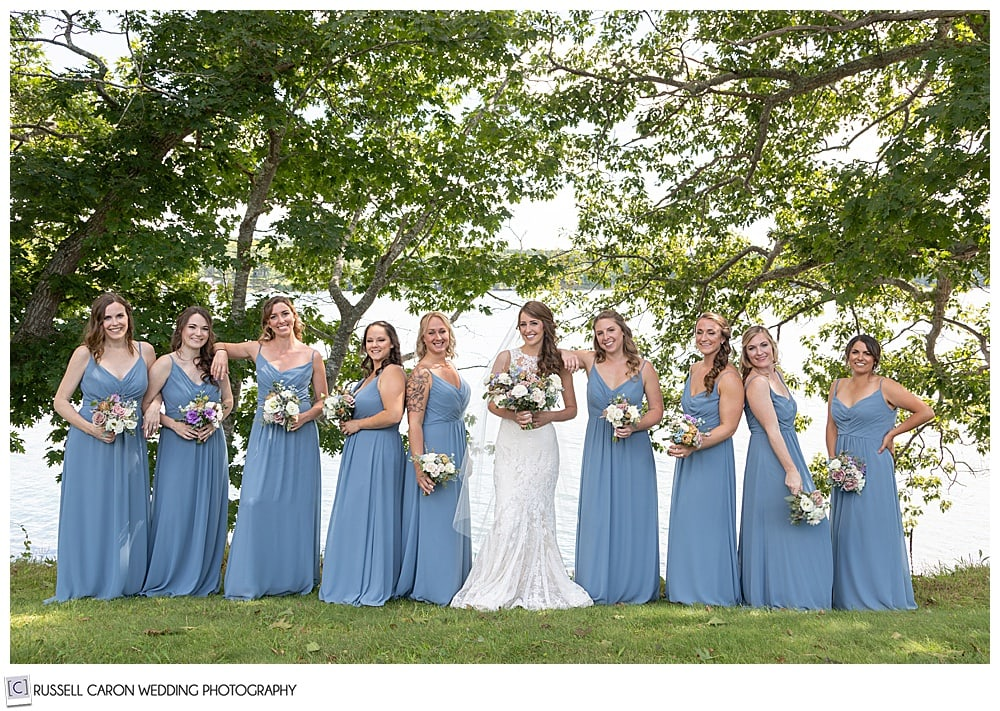 bride in white, with bridesmaids in light blue, at Fort Edgecomb, Edgecomb, Maine