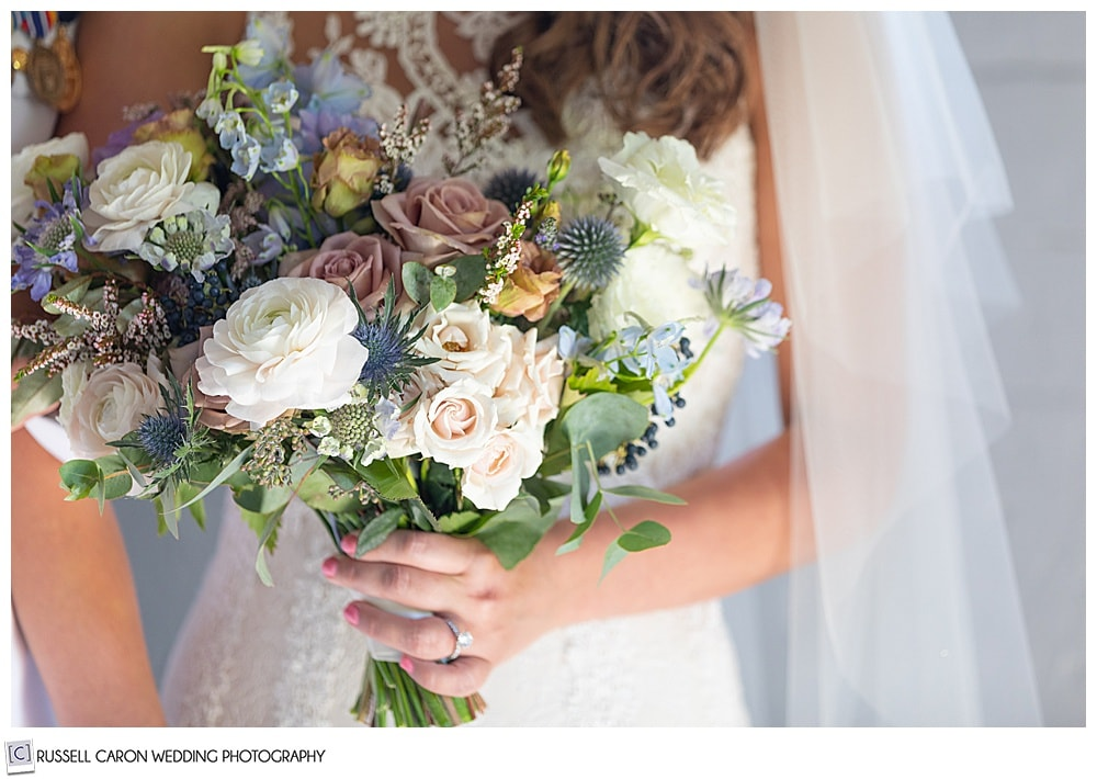 bride holding a beautiful bouquet by Honeysuckle Way Flowers