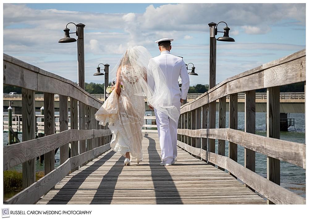 bride and groom walking down the dock at Sheepscot Harbor Village Resort