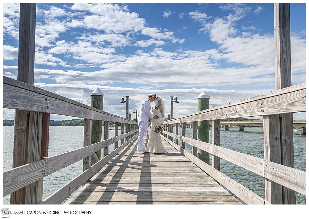 bride and groom kissing on the dock at the Sheepscot Harbour Village Resort
