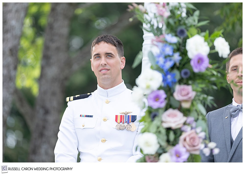 groom in dress whites waits for his bride