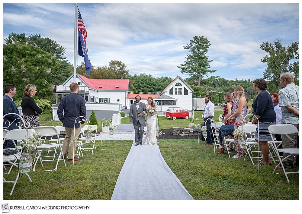 bride and her father walking down the aisle at their Maine backyard wedding