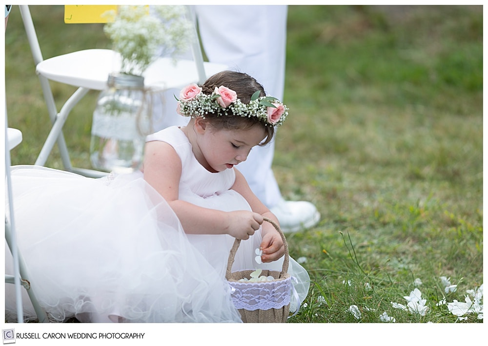 flower girls playing with flower petals