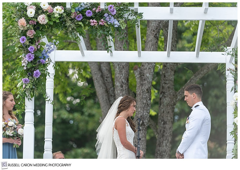 bride reciting her vows to her groom during their backyard Dresden Maine wedding ceremony