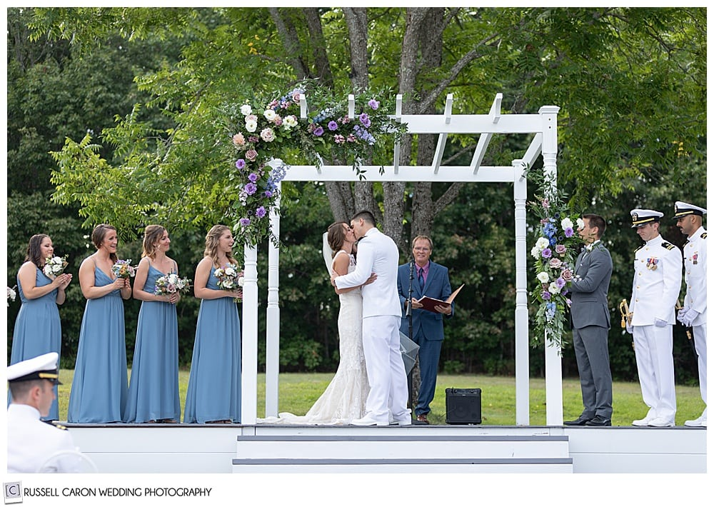 bride and groom's first kiss at their Dresden Maine wedding ceremony