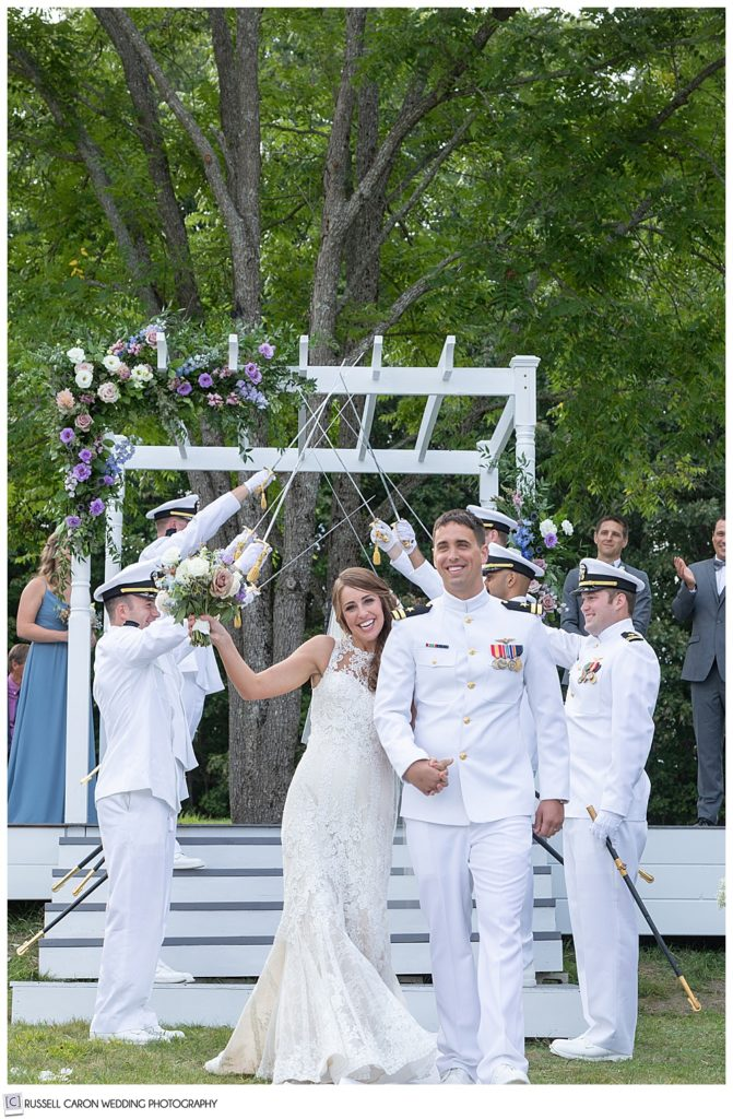 bride and groom during the recessional after going through a sword arch at their Dresden Maine wedding