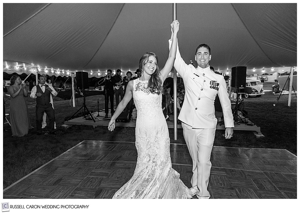 black and white photo of bride and groom being announced into their first dance