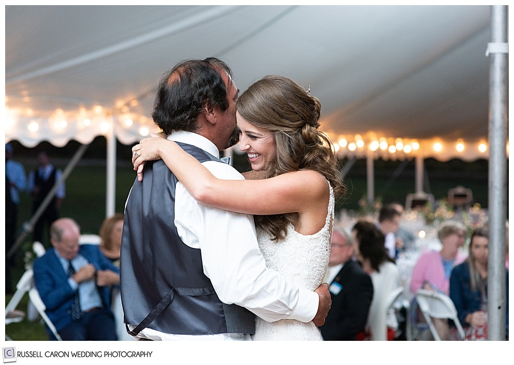 father daughter dance, bride is smiling