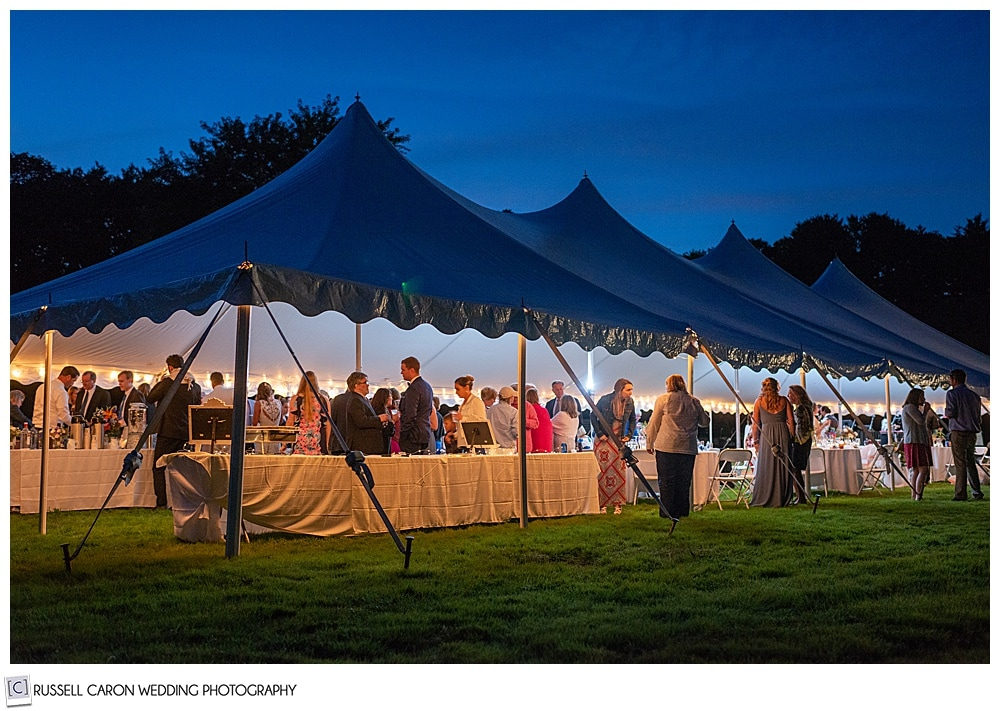 photo of a tented wedding during twilight in Maine