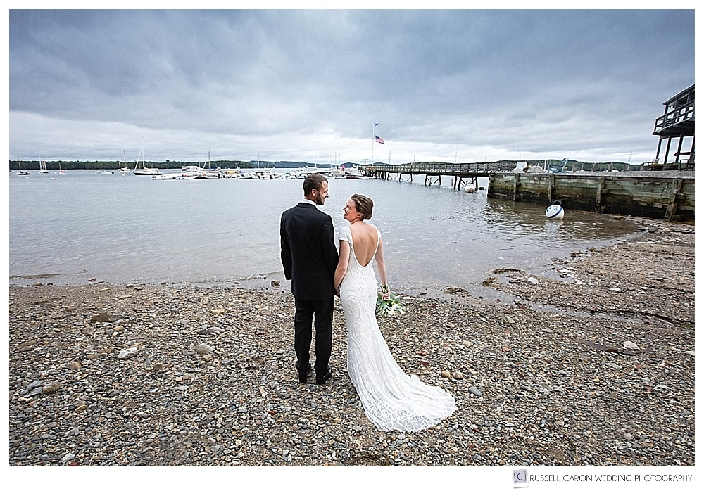 bride and groom standing together on a beach at Castine Maine