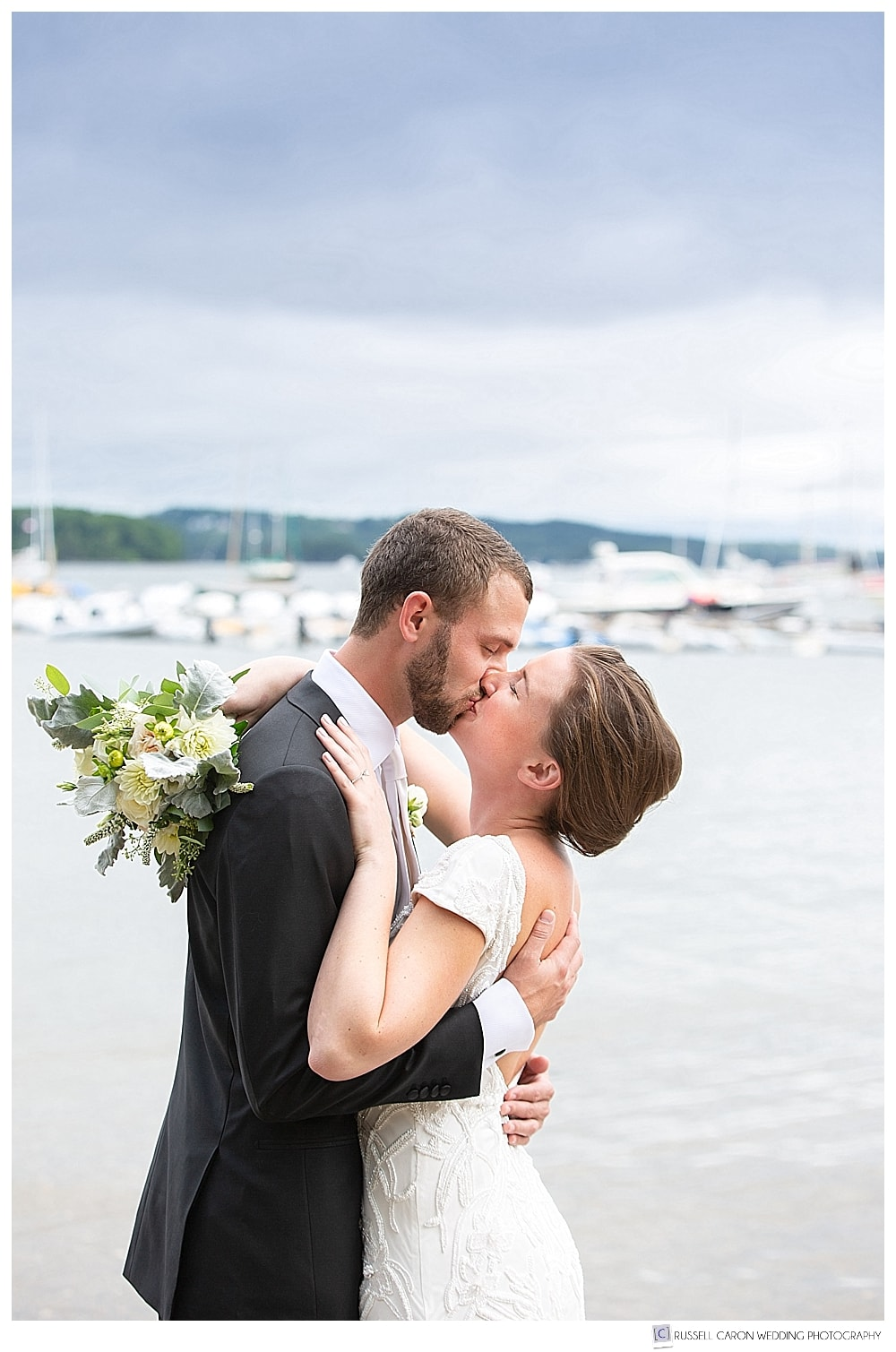 bride and groom kissing on a dock in Castine, Maine