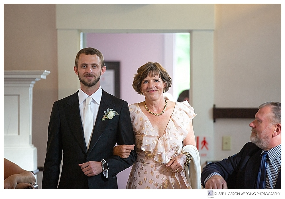 Groom and his mother during a wedding processional at the Unitarian Universalist Church in Castine, Maine