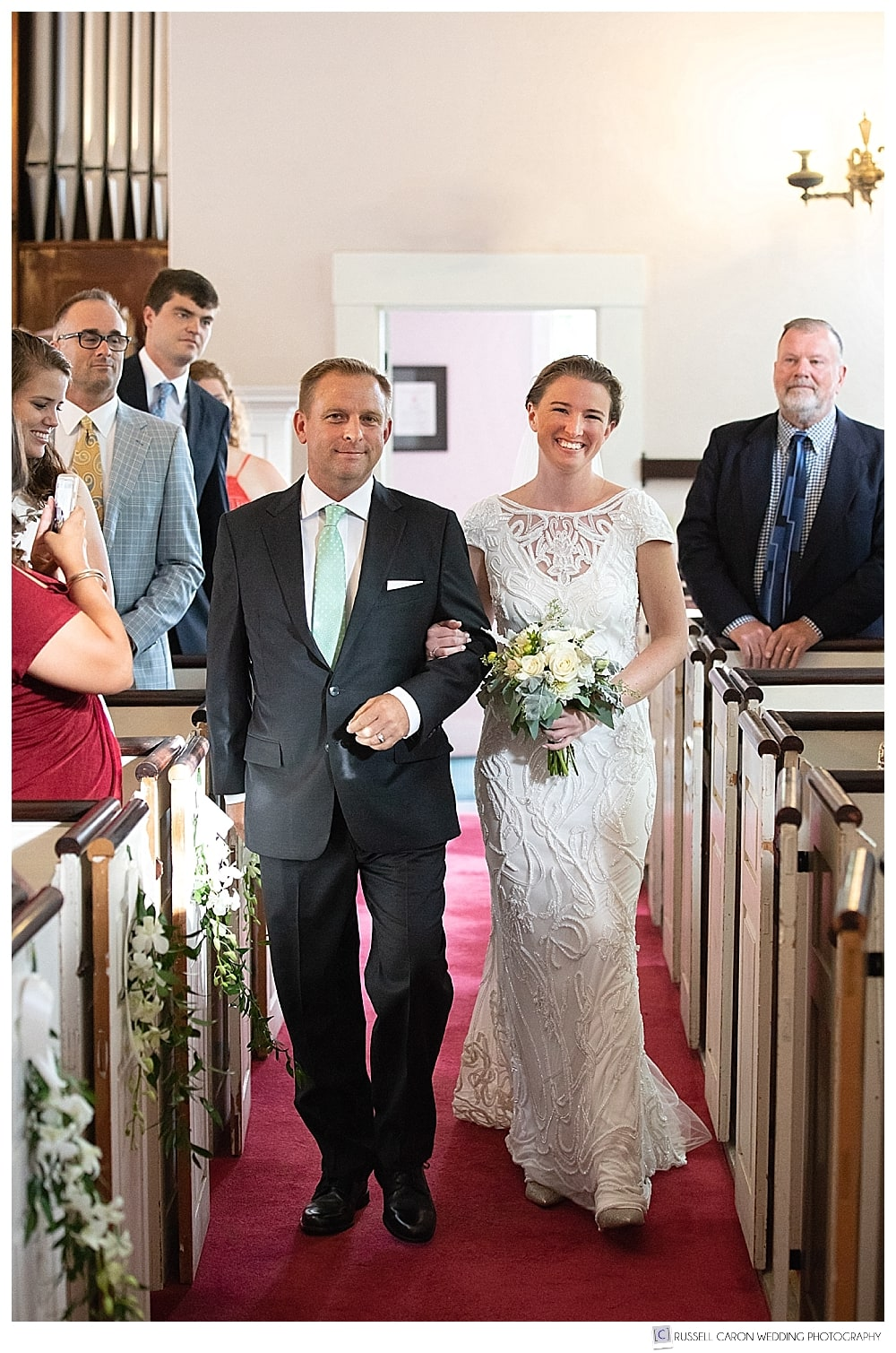 Bride and her father during a wedding processional at the Castine, Maine, Unitarian Universalist Church