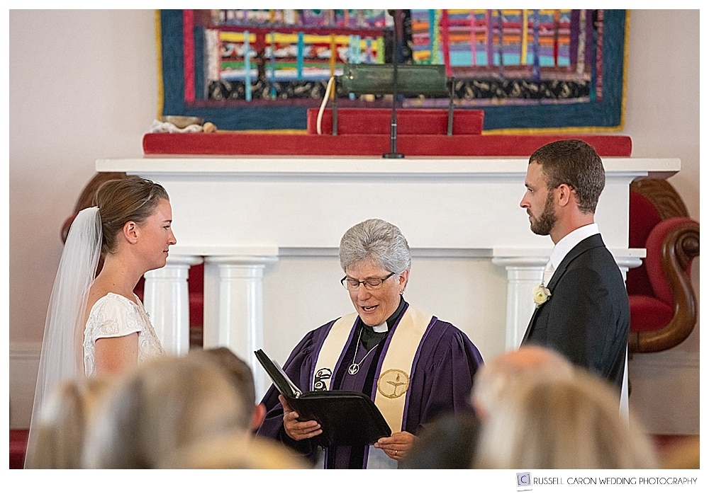 Bride and groom during wedding ceremony at the UU Church in Castine, Maine