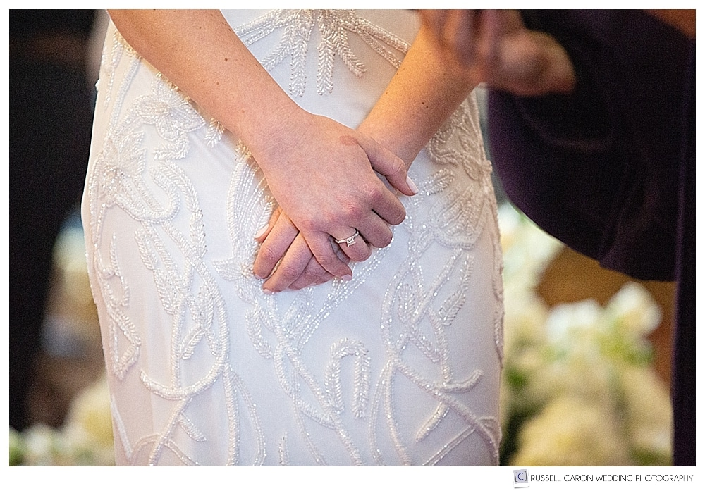 Bride's hands during wedding ceremony