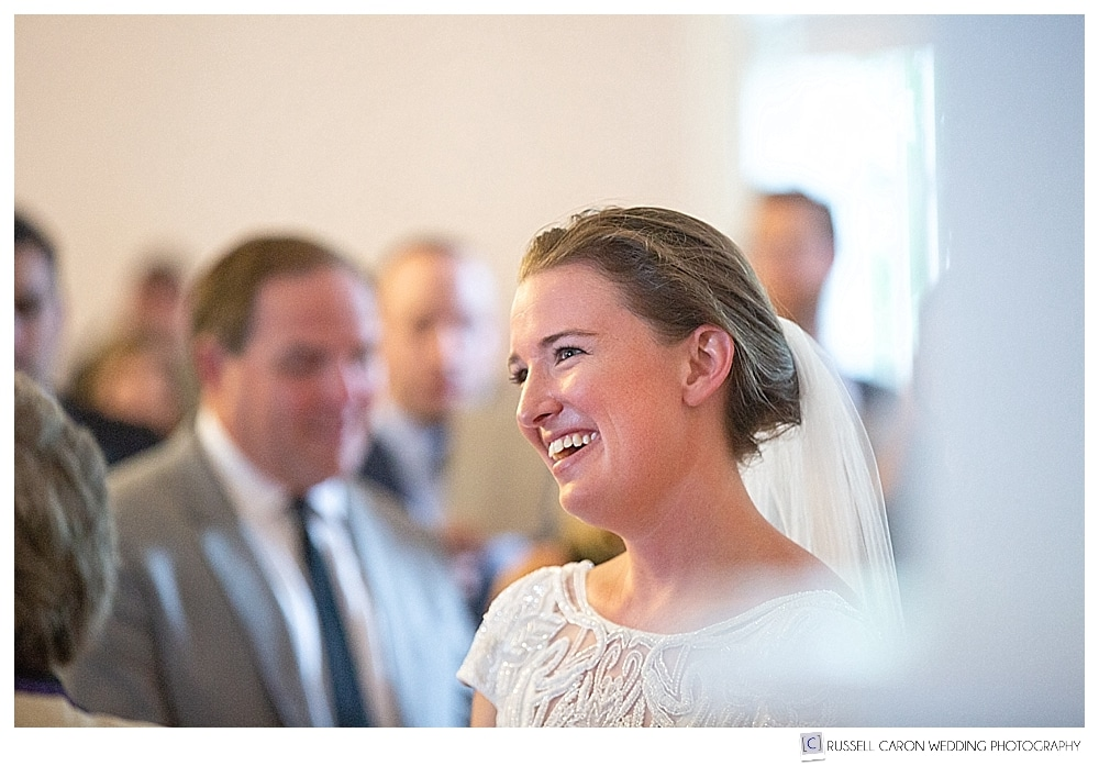 Bride smiling during wedding ceremony