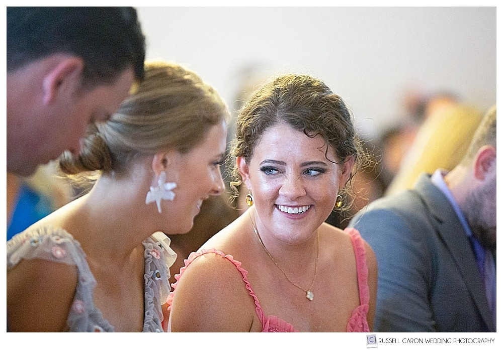 Guests smiling during wedding ceremony
