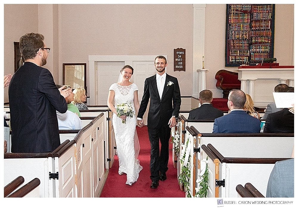 Bride and groom during the recessional at their Castine, Maine wedding