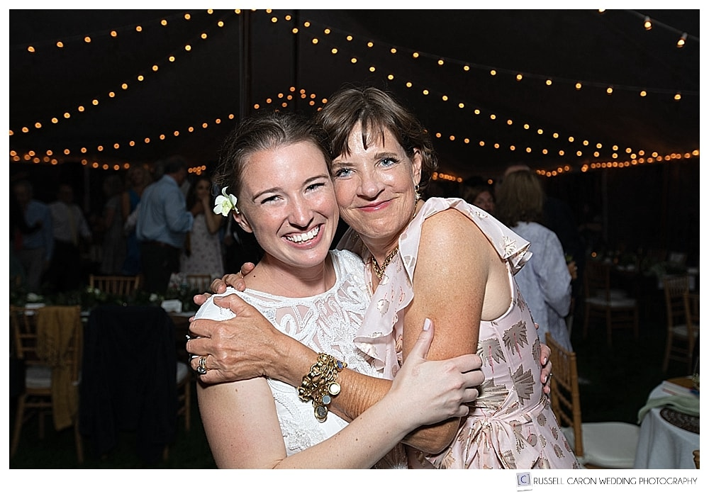 Bride and her new mother-in-law during tented wedding reception