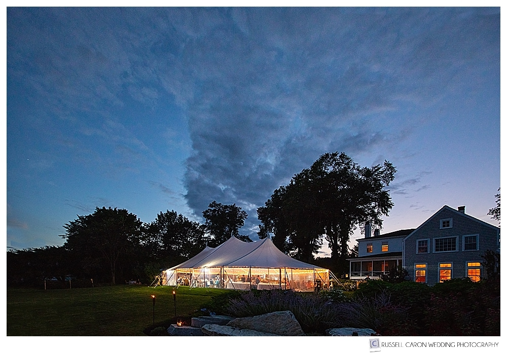 Tented wedding reception at dusk, tent by Wallace Events