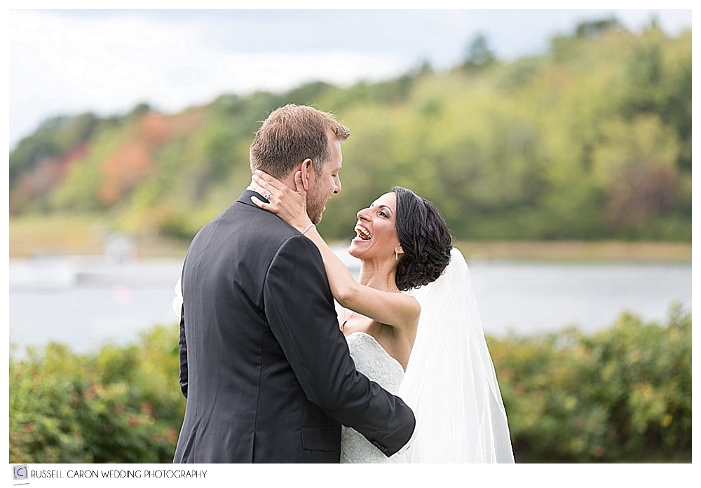 Bride and groom come together during wedding day first look at elegant Nonantum Resort wedding, Kennebunkport, Maine