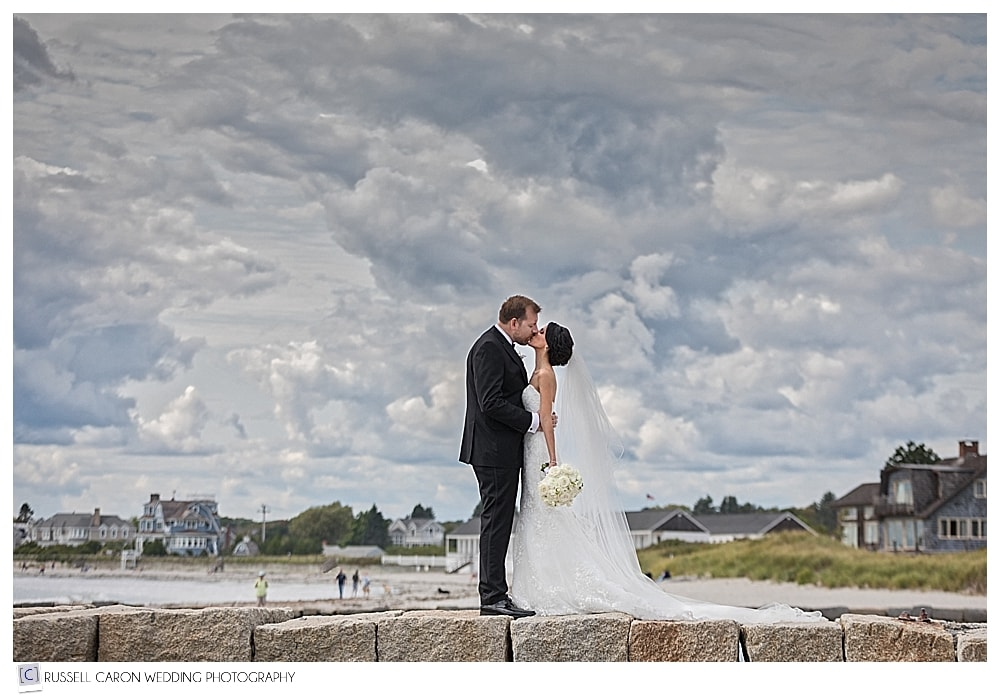 bride and groom on the breakwater in Kennebunkport Maine