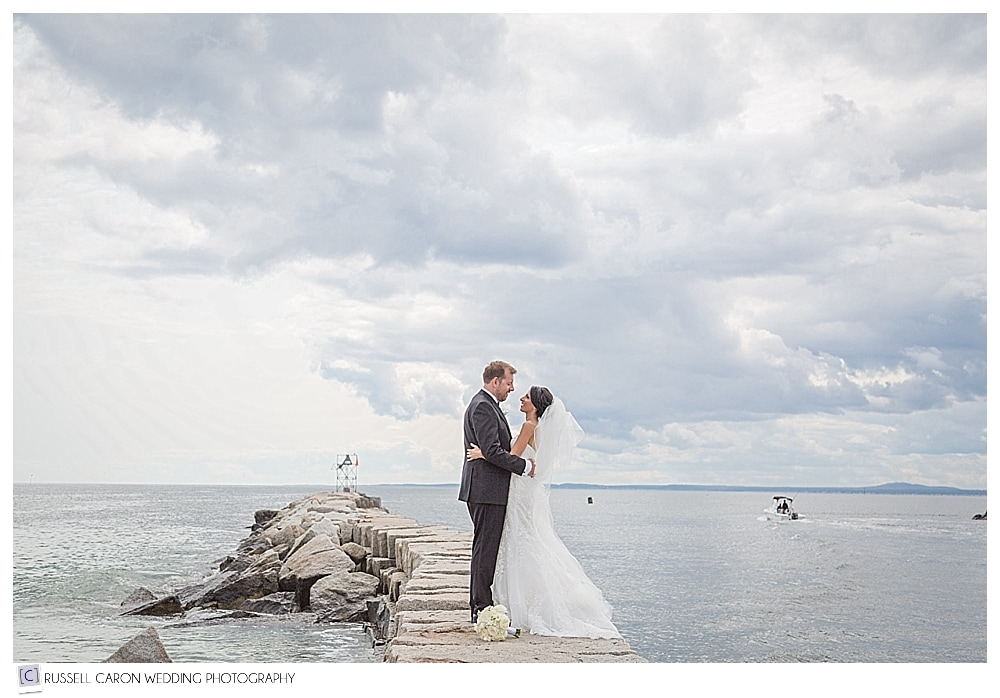 Bride and groom on the breakwater Kennebunkport Maine