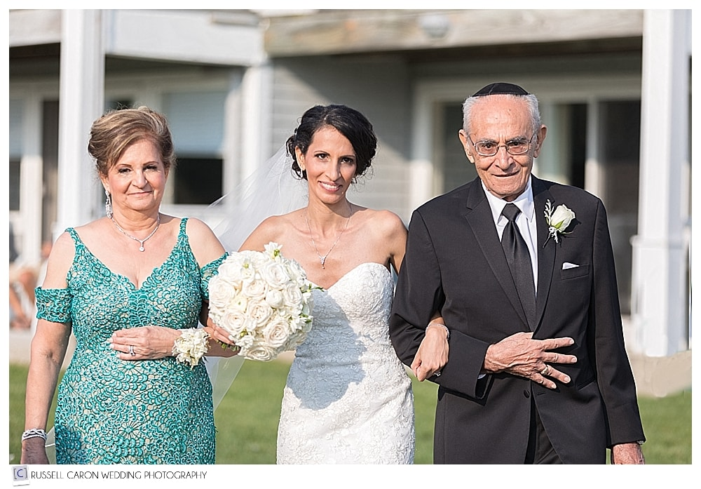 bride walking down the aisle with her parents at the Nonantum Resort, Kennebunkport, Maine