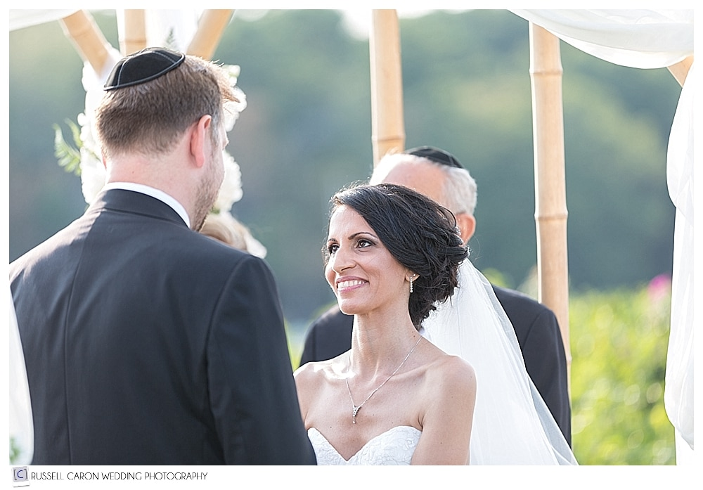 bride looks at groom during jewish wedding ceremony