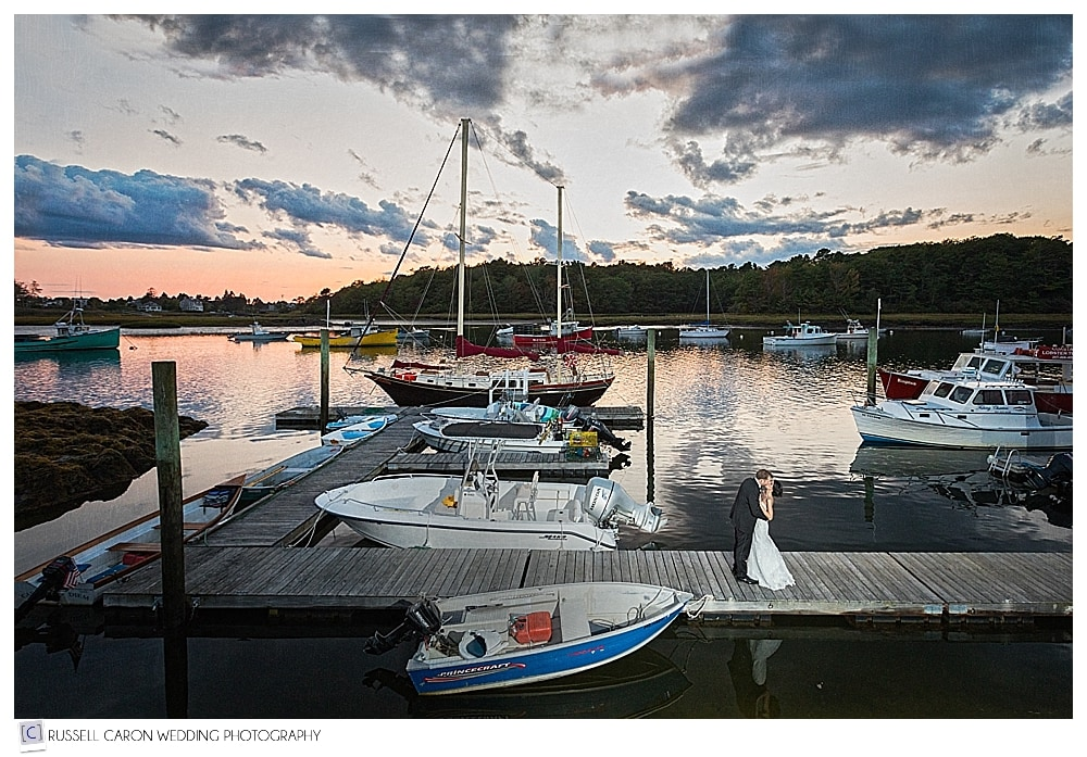 bride and groom on the Nonantum Resort dock at sunset, Kennebunkport Maine wedding photographers