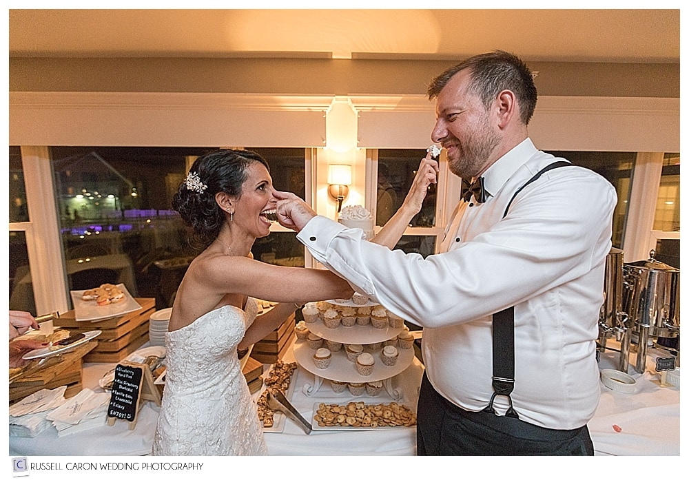 Bride and groom during cupcake exchange