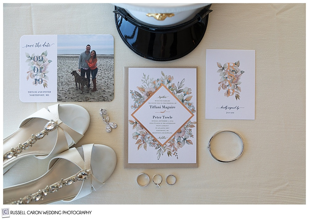 wedding day detail photo of rings, wedding invitation, bride's shoes, groom's military hat