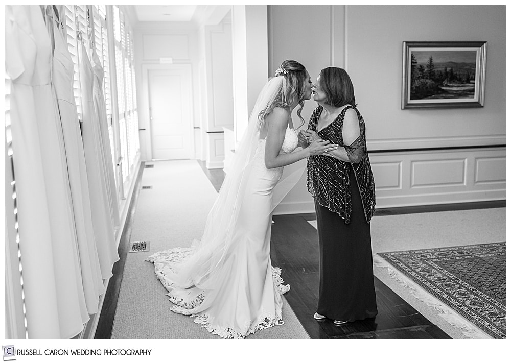 black and white photo of the bride and her mother kissing