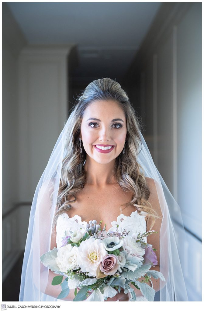 beautiful bridal portrait of a bride standing in a hallway