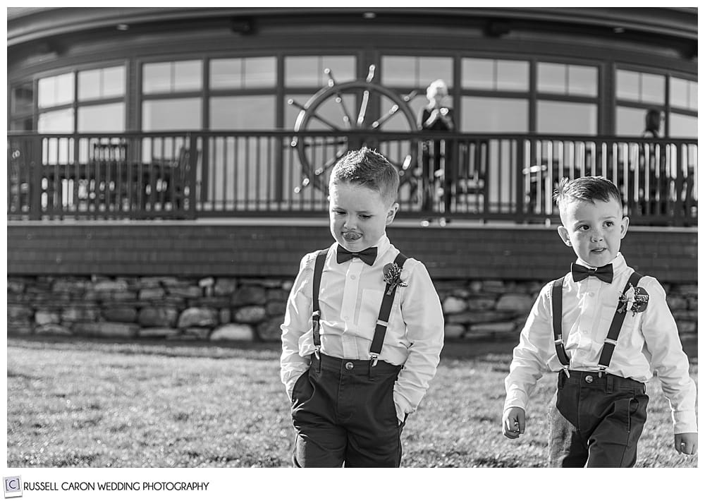 black and white photo of two ring bearers walking down the aisle during an elegant point lookout wedding