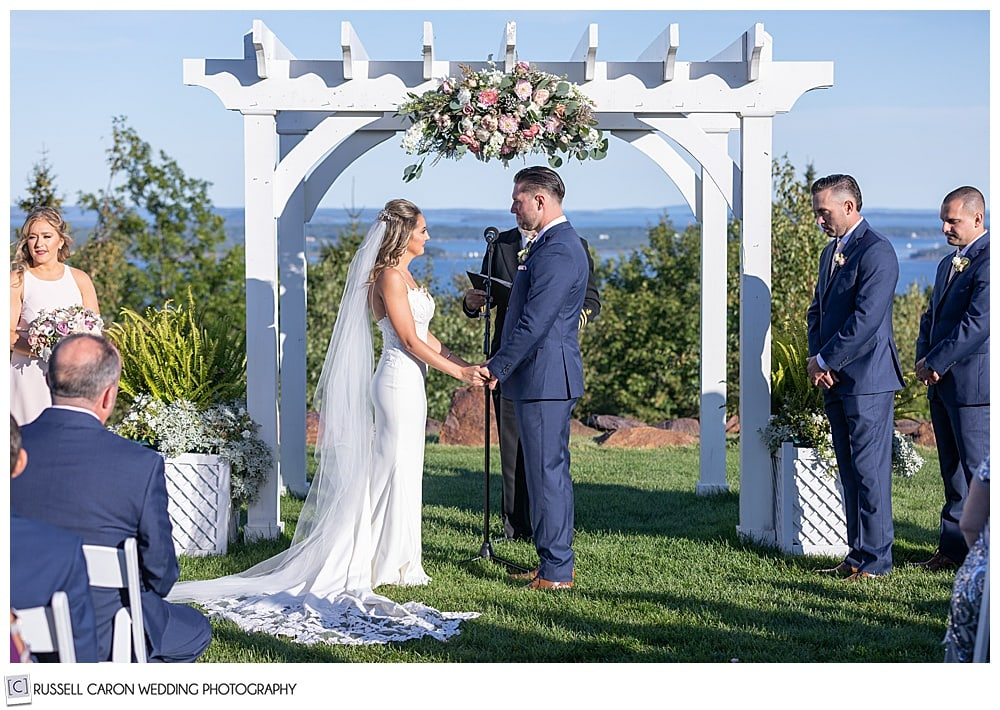 bride and groom stand together at their elegant point lookout wedding ceremony