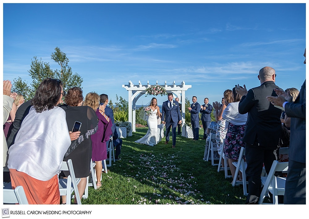 bride and groom recessional at their elegant point lookout wedding ceremony, Northport, Maine