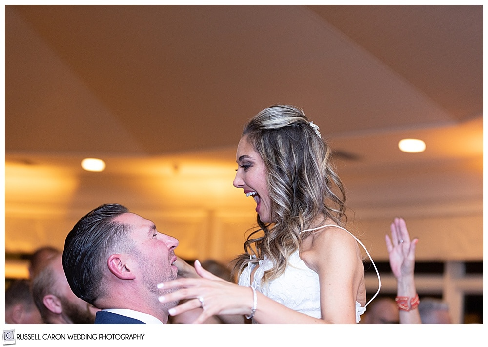groom lifts bride as they're dancing, you see their heads