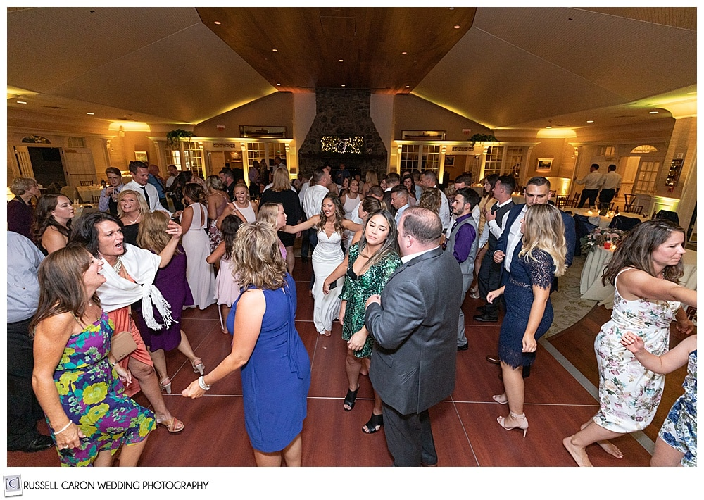 bride with two of her friends, in the middle of the dance floor at her elegant point lookout wedding reception