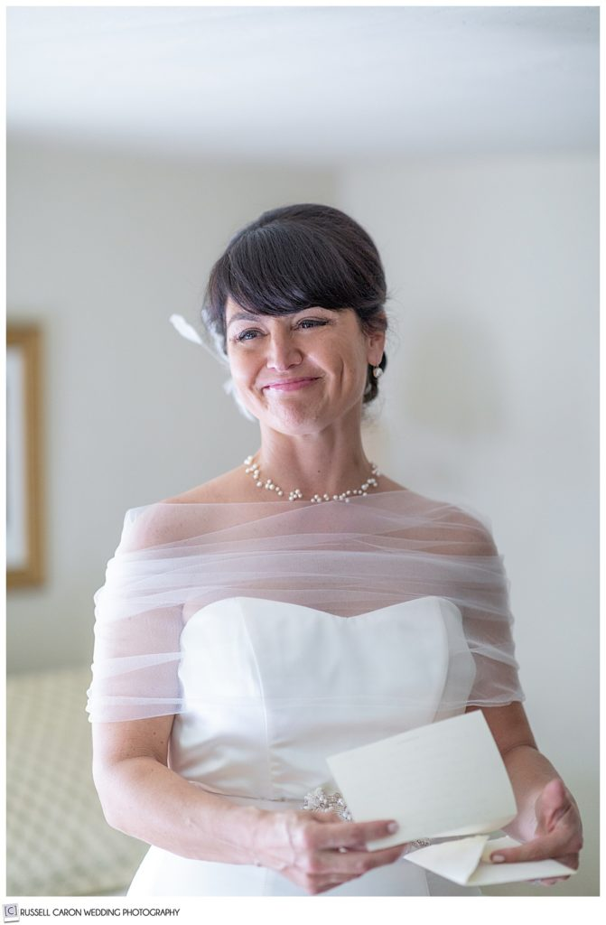 bride smiling with letter in hand