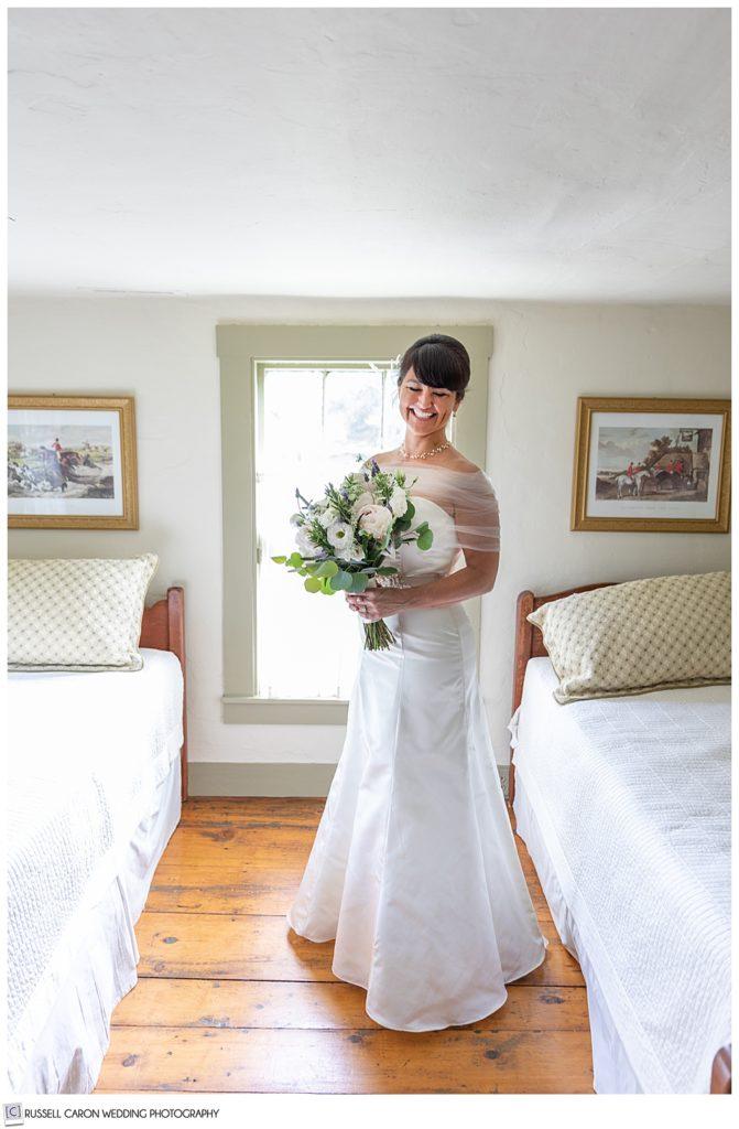 smiling bride standing in bedroom