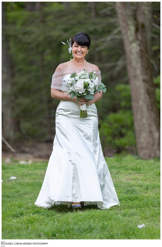 smiling bride walking down the aisle